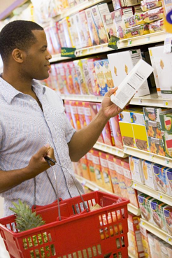 Man reading food label resized 600