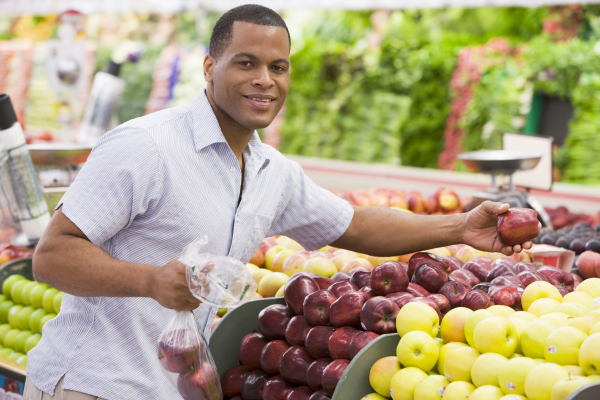 man shopping in produce resized 600