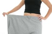 WeightLoss holdingpants resized 600