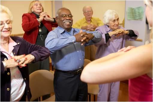 seniors in a stretching class
