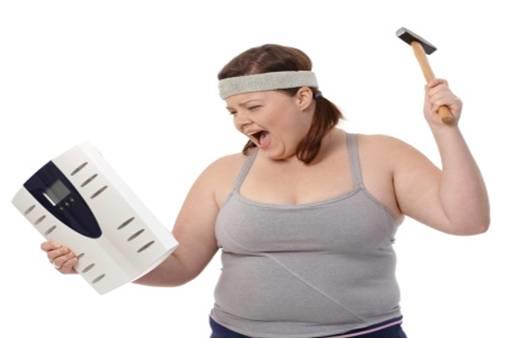 woman hitting scale