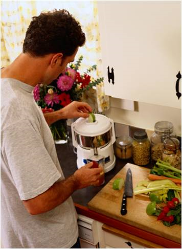 man using a juicer