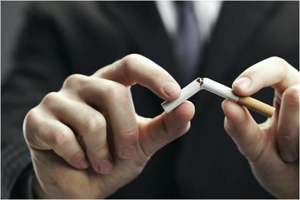 man breaking cigarette