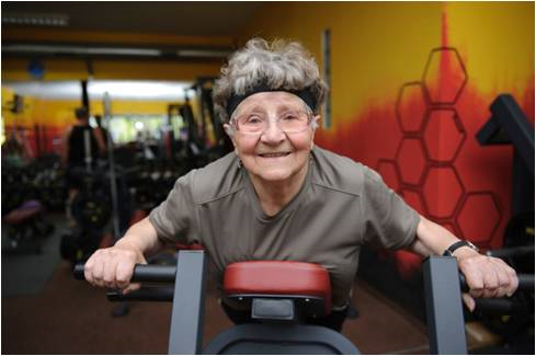 elderly woman pumping iron