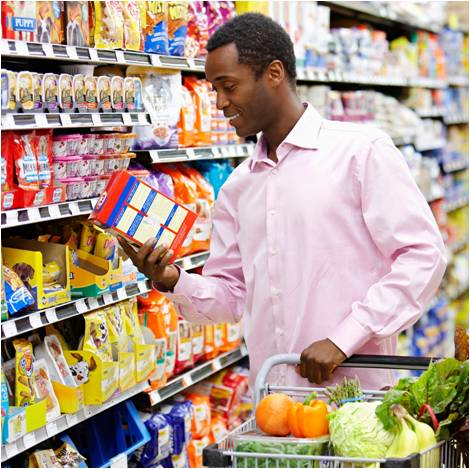 man reviewing food label resized 600