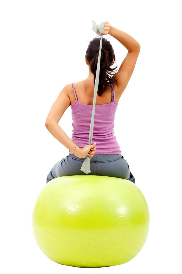 woman using exercise band resized 600