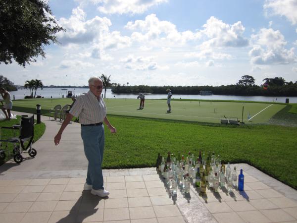Mr. Brauntuch Volunteer wine bottle ring toss resized 600