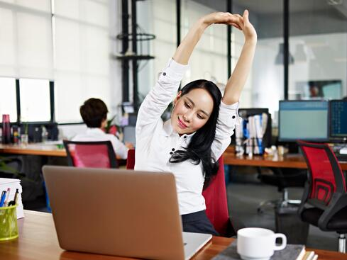 Woman at Computer Stretching GettyImages-501332192.jpg